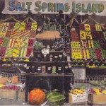 A coloured display of Salt Spring produce at the Saanich (Victoria) Fall Fair - 1918. NOTE: Since this photo was originally taken as a black and white, recently a local artist used watercolour to paint in the colour. The colour patterns stand out so well.