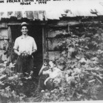 "Frank and Don Fraser (Lotus Ruckle's brothers) at the Menhinick cider house in 1945. Cory Menhinick came to Salt Spring Island in 1920 purchasing a large parcel of land near the Beaver Point Hall, comprising what is not Wave Hill Farm. Lots of farmers made cider on Salt Spring, but none made it as clear and sparkling as Cory did. His favourite apples, the Gravensteins were fermented with barley sugar to create a cider that has been called, ""the best champagne.' Cider sold for 75cents a gallon and that was the main farm income in the1920's, helping to put food on the table. In the 1930's, cider parties were popular on Salt Spring. Lotus Ruckle spent here teenage years on the farm, as Cory was her step father."