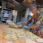 Heather, the Bread Lady baking apple laden focaccia for Apple Festival 2011. Her mouth watering breads and baked treats are all baked in a wood fired oven. A must to see and taste. http://www.phillipvanhorndesign.com/bakery/index.html Photo by Karen Mouat