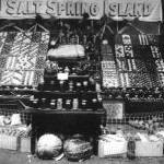 A display of Salt Spring produce at the Saanich (Victoria) Fall Fair - 1918. Note the geometrical arrangements of the various colours of apples to make such great colour patterns.