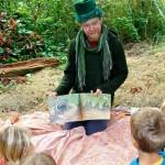 Children's story teller, Christoph Weeks has kids listening intently sitting under a Gravenstein apple tree