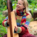 Oona McOuat, plays her harp as she tells the story of the Magic Apple to children at the Apple Festival.