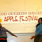 Volunteers Kayah and Deanna Ziraldo, show off one of our apple banners.